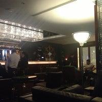 Photo taken at ICON Bar & Lounge by Ayman I. on 3/13/2013