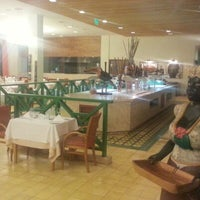 Photo taken at Restaurante Bahia & Brasa Grand Palladium by Roberto C. on 11/23/2012