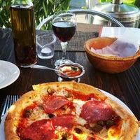 Photo taken at Cafe Bella Italia by Evan M. on 6/6/2014