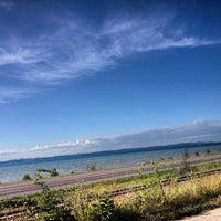 Photo taken at West Arm Grand Traverse Bay by Ryan B. on 8/2/2013