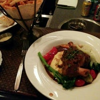 Photo taken at Bouchons Bistro by Stephen W. on 11/29/2015