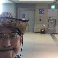 Photo taken at Gate 45 by Kohei K. on 8/3/2016