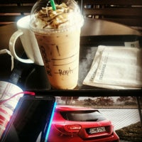 Photo taken at Starbucks Coffee by Raph E. on 10/2/2014