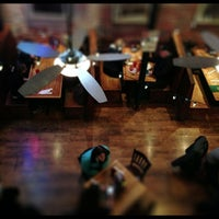 Photo taken at Brews Cafe by Kevin D. on 3/2/2013