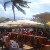 Photo taken at Tiki Bar at Riptide Hotel by Tim J. on 7/4/2013