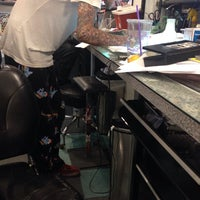 Photo taken at Tattoo Mania by Jamie S. on 6/22/2014