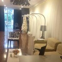 Photo taken at Vera Wang Bridal Salon by Loan P. on 7/15/2014