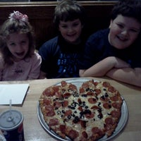Photo taken at Rustys Pizza by Michael E. on 2/15/2013