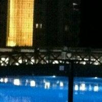 Photo taken at Grand Park Lara Otel Swimming Pool by Mustafa G. on 8/11/2015