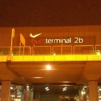 Photo taken at Terminal 2B by Alex B. on 3/15/2013