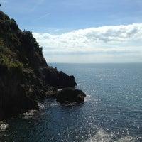 Photo taken at Spiaggia di Riomaggiore by Lauren F. on 9/14/2013