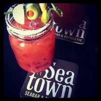 Photo taken at Seatown Seabar & Rotisserie by Catie C. on 6/2/2013