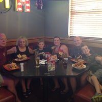 Photo taken at Red Robin Gourmet Burgers by Jeannette B. on 7/5/2014