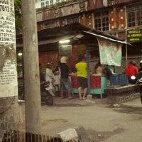 Photo taken at Dagang Nasi Kuning by Yoki D. on 6/18/2013
