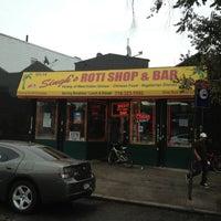 Photo taken at Singh's Roti Shop by Vipul P. on 10/7/2012