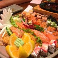 Photo taken at Yosugiru Sushi by Aline P. on 2/13/2013