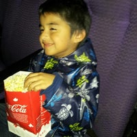 Photo taken at Cinemark Movies 8 by Gracie G. on 1/10/2013