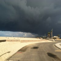 Photo taken at Huntington State Beach by Colleen A. on 10/12/2012