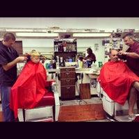 Photo taken at Little Joe & John's Barber Shop by Sarah G. on 1/16/2013