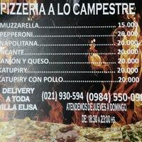 Photo taken at Pizzería A lo Campestre by Alexa G. on 12/27/2014
