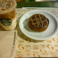 Photo taken at Starbucks by Andrea V. on 5/12/2013