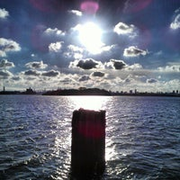 Photo taken at Barretto Point Park by Milton on 10/18/2012