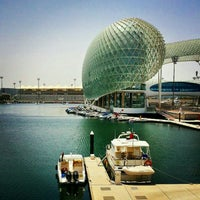 Photo taken at Yas Marina & Yacht Club by Feyza P. on 5/19/2015