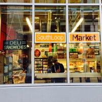 Photo taken at South Loop Market by Derek Q. on 9/25/2013