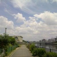 Photo taken at 神崎川河川敷 by Shinichi M. on 6/24/2013