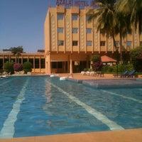 Photo taken at Azalai Hotel Independance Ouagadougou by Baris S. on 2/14/2013