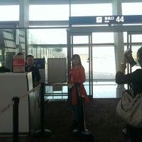 Photo taken at Gate 44 by Radhae K. on 11/12/2013