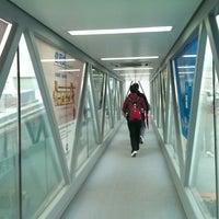 Photo taken at Gate 207 by Radhae K. on 10/23/2013