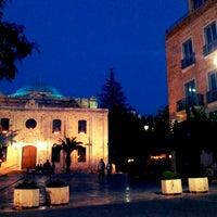 Photo taken at Saint Titos Square by Pavlos E. on 7/8/2013