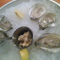 Photo taken at Dylan's Oyster Cellar by Claire O. on 3/1/2014