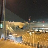 Photo taken at Gate 18 by Ryuji A. on 12/22/2012