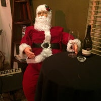 Photo taken at Cava Wine Bar by Katie G. on 12/6/2014