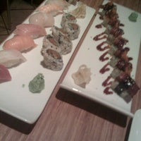 Photo taken at Pinto Thai Bistro & Sushi Bar by Nik B. on 10/10/2012