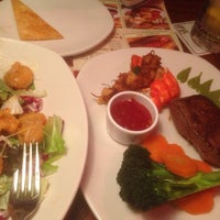 Photo taken at OUTBACK Steakhouse by Younsoo S. on 1/25/2014