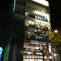 Photo taken at Tsutaya Book Store Tenjin by Connie L. on 6/30/2013