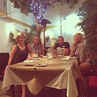 Photo taken at Bijou Bar and Bistro by Violetta  R. on 7/10/2014