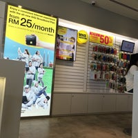 Photo taken at DiGi Store™ by SherryWan  예. on 11/20/2014