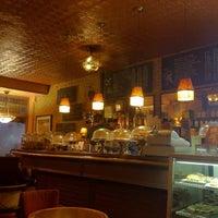 Photo taken at Tango Palace Coffee Company by Art L. on 12/1/2012