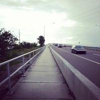 Photo taken at Eau Gallie Causeway by John C. on 9/12/2013