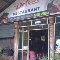 Photo taken at Delish Restaurant by Leaf C. on 8/24/2013