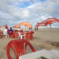 Photo taken at Praia by Gabriela I. on 11/16/2012