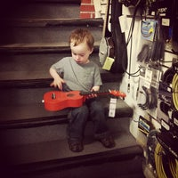 Photo taken at Rufus Guitar Shop by Kim W. on 8/20/2013
