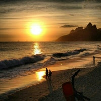 Photo taken at Ipanema Beach by Ariele M. on 7/22/2013