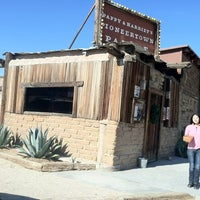 Photo taken at Pappy & Harriet's Pioneertown Palace by Christopher K. on 12/18/2012