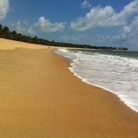 Photo taken at Praia Boca da Barra by Flávio A. on 12/29/2013