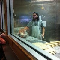 Photo taken at Dewey's Pizza by Erika M. on 12/8/2012